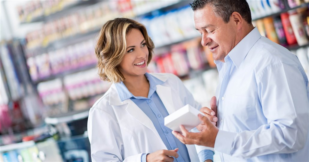man talking to pharmacist